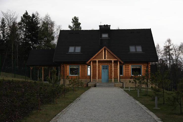 Casa di legno in stile  di LK & Projekt Sp. z o.o.