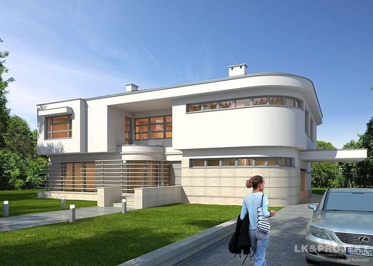 LK&909: styl , w kategorii Domy zaprojektowany przez LK & Projekt Sp. z o.o.,Nowoczesny
