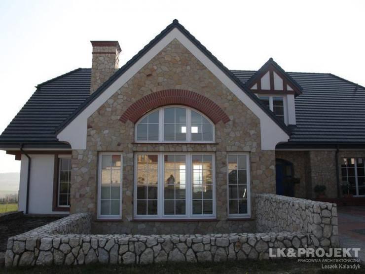 LK&700 realizacja: styl , w kategorii Domy zaprojektowany przez LK & Projekt Sp. z o.o.