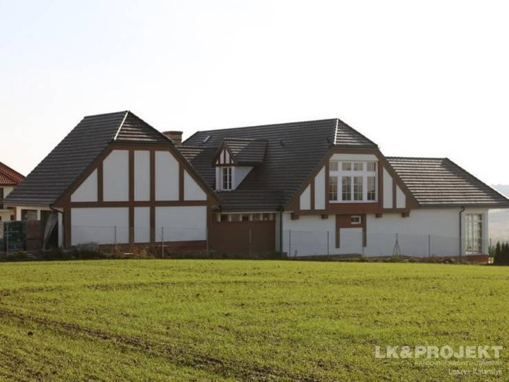 LK&700 realizacja: styl , w kategorii Domy zaprojektowany przez LK & Projekt Sp. z o.o.,