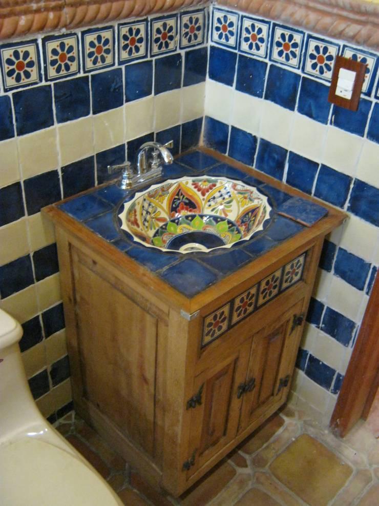 Casa de descanso fl: Baños de estilo  por ipalma arquitectos