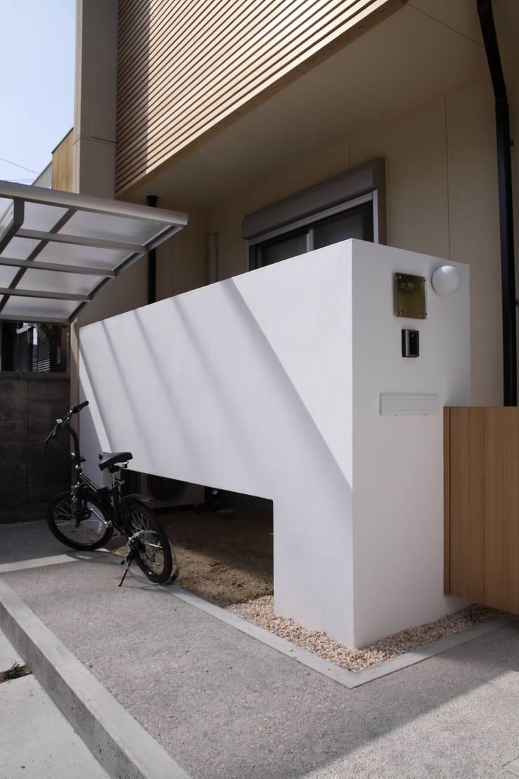 塀: 加藤一高建築設計事務所が手掛けた家です。