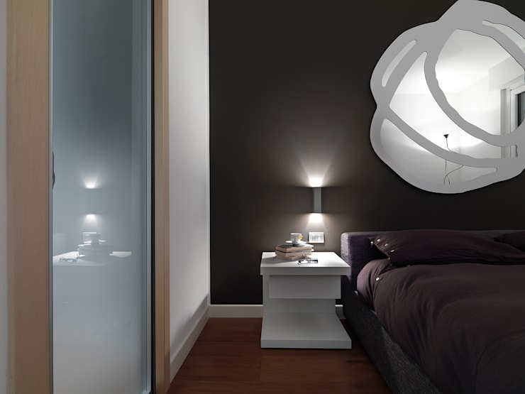 Attico in centro a Milano: Camera da letto in stile  di D3 Architetti Associati