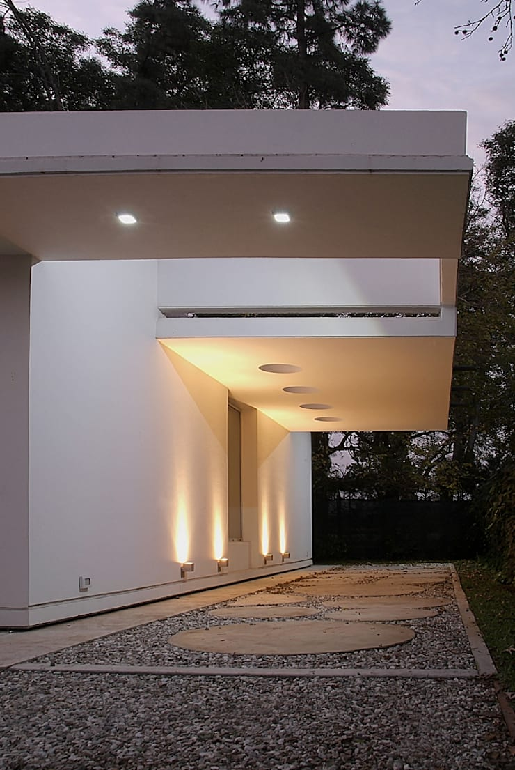 CASA ANDRADA: Casas de estilo  por METODO33