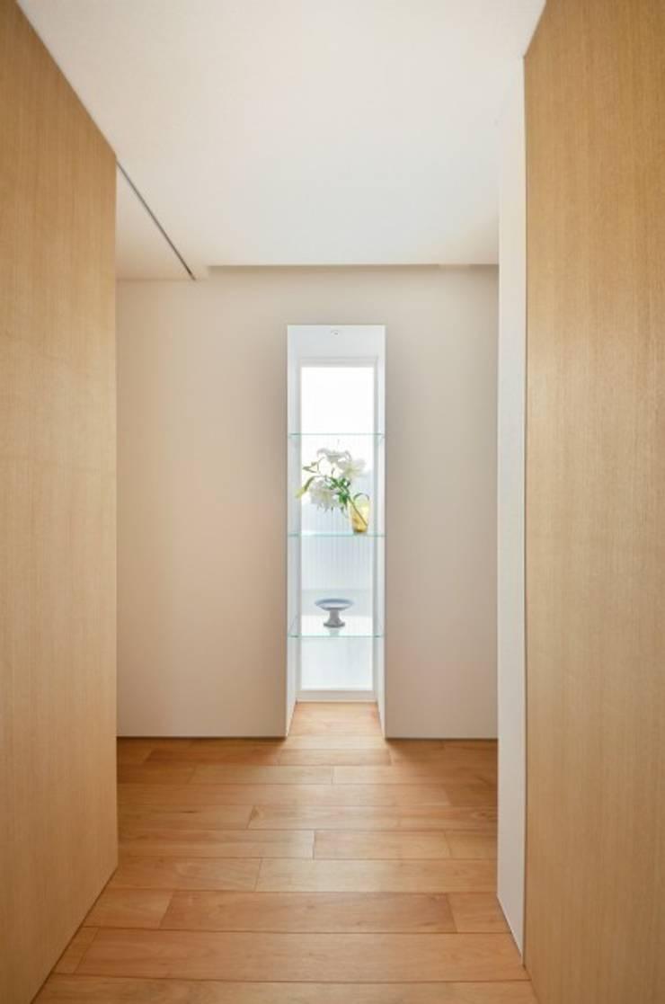 小さな平屋: 岩田建築アトリエが手掛けた和室です。