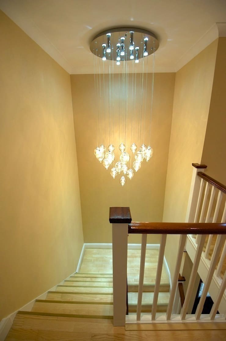 Statement light over staircase:  Corridor, hallway & stairs by Chameleon Designs Interiors