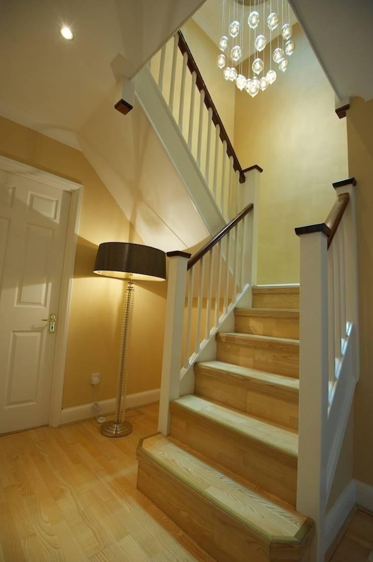 Hallway and stairwell lighting:  Corridor, hallway & stairs by Chameleon Designs Interiors
