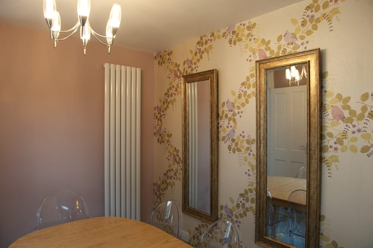Dining area feature wall and new radiator and light.:  Dining room by Chameleon Designs Interiors