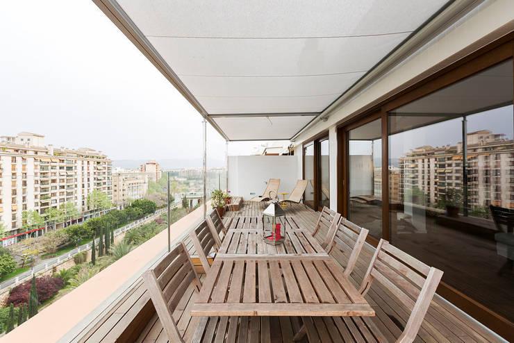 ÁTICO LOFT TK: Jardines de invierno de estilo  de RM arquitectura
