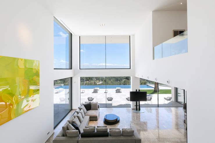 CASA SV II: Salones de estilo  de RM arquitectura