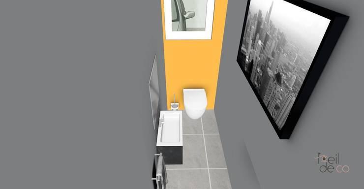 Toilettes: Salle de bains de style  par L'Oeil DeCo