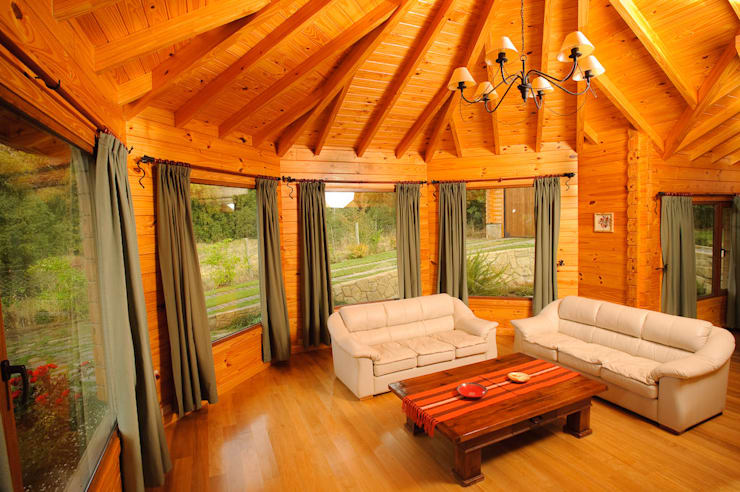 Salas de estilo  por Patagonia Log Homes