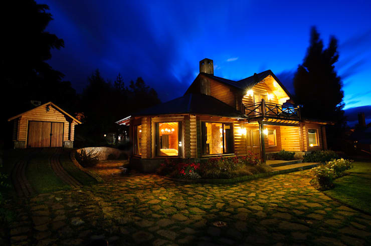 Casas unifamiliares de estilo  por Patagonia Log Homes