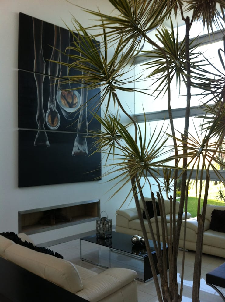 Living room by ARKIZA ARQUITECTOS by Arq. Jacqueline Zago Hurtado   ,