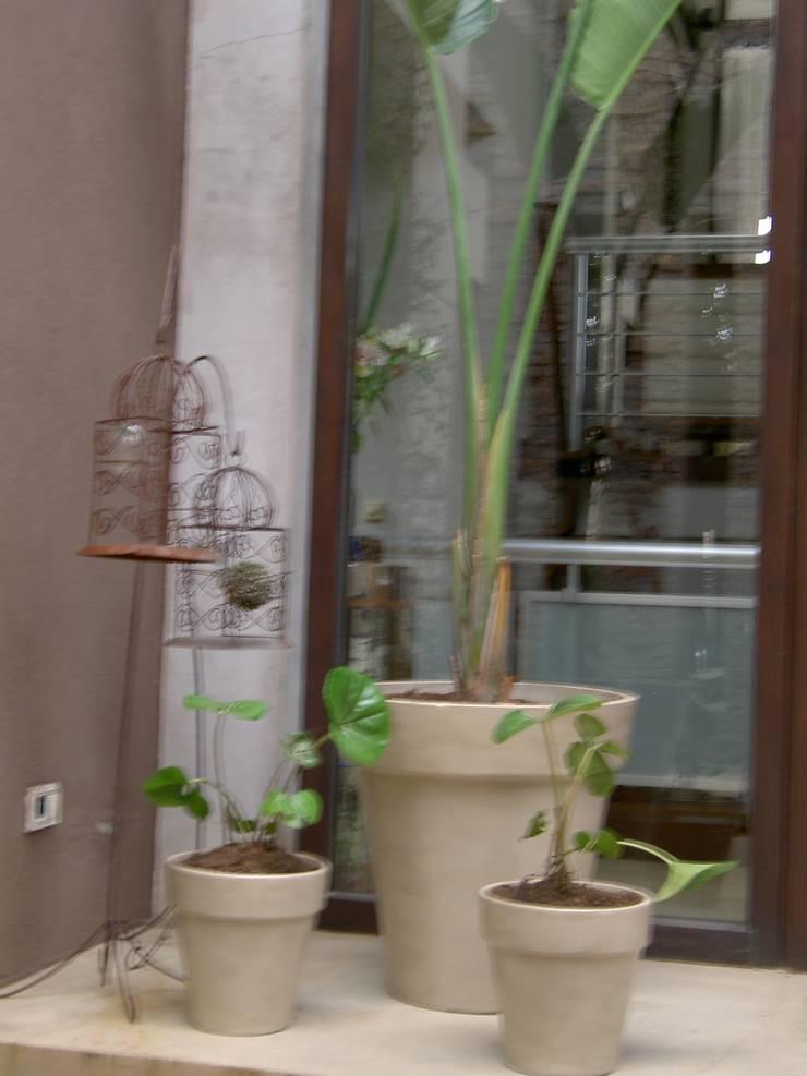 macetas: Jardines de estilo  por BAIRES GREEN MUEBLES
