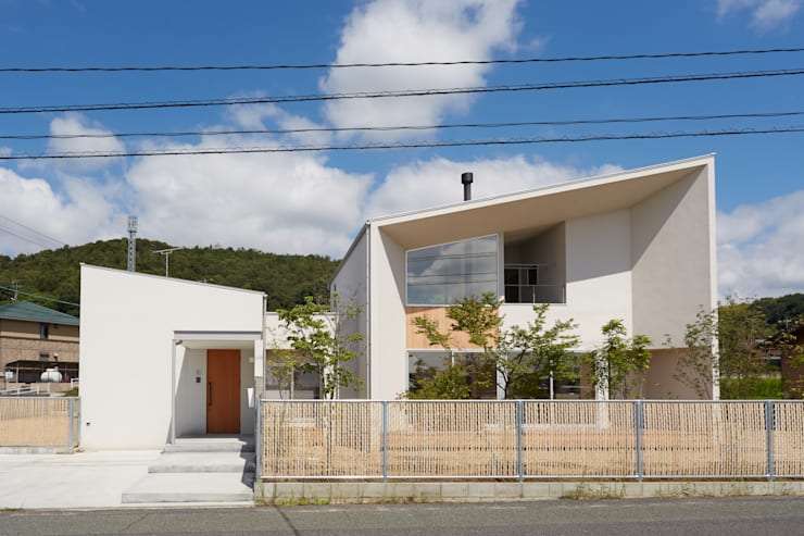 Casas de estilo  por toki Architect design office