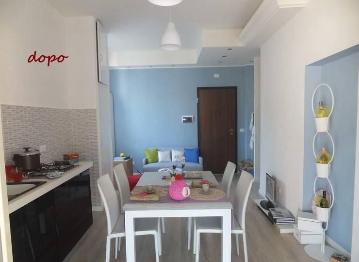 New look per un appartamento di 70 mq a Terni:  in stile  di EFFEtto Home Staging