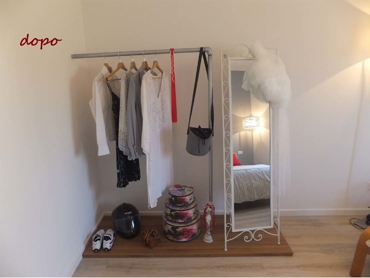 Vestidores y closets de estilo  por EFFEtto Home Staging