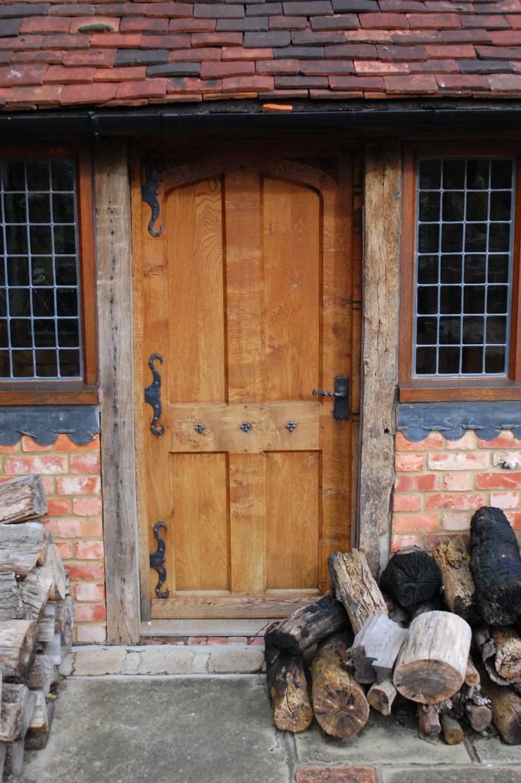 Panelled oak door:  Houses by Arttus