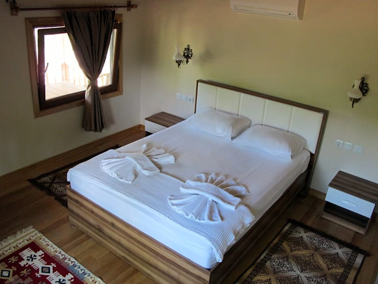 Bedroom by Cıralı Beach Bungalows