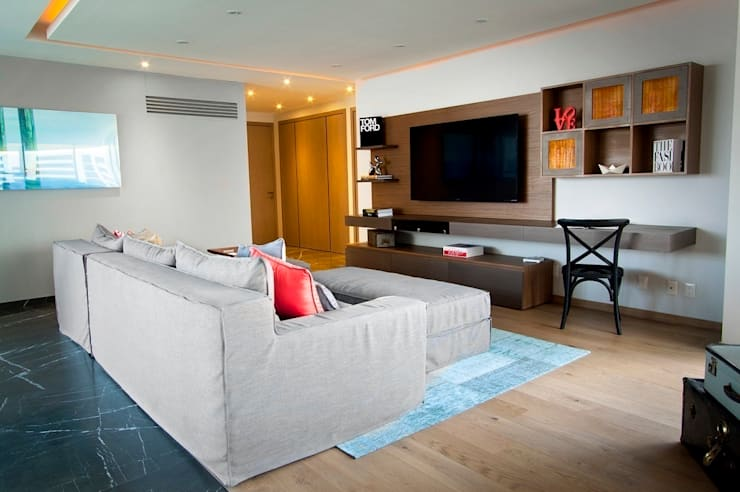 Salas de entretenimiento de estilo moderno por Concepto Taller de Arquitectura