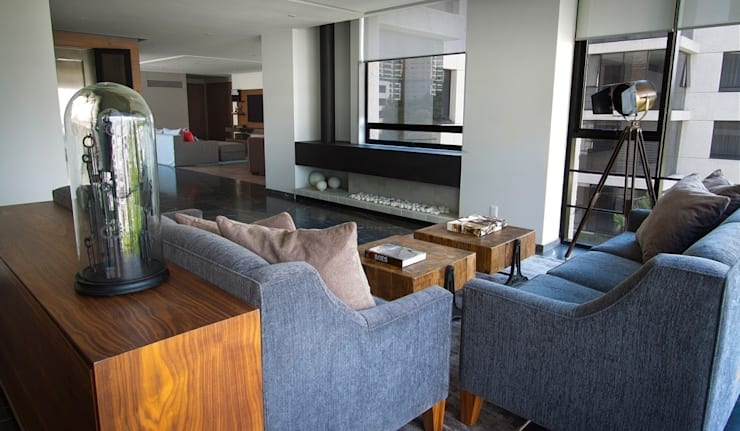 Departamento CL: Salas de estilo  por Concepto Taller de Arquitectura