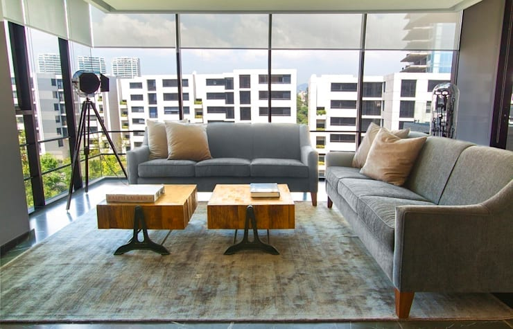 Departamento CL: Salas de estilo moderno por Concepto Taller de Arquitectura