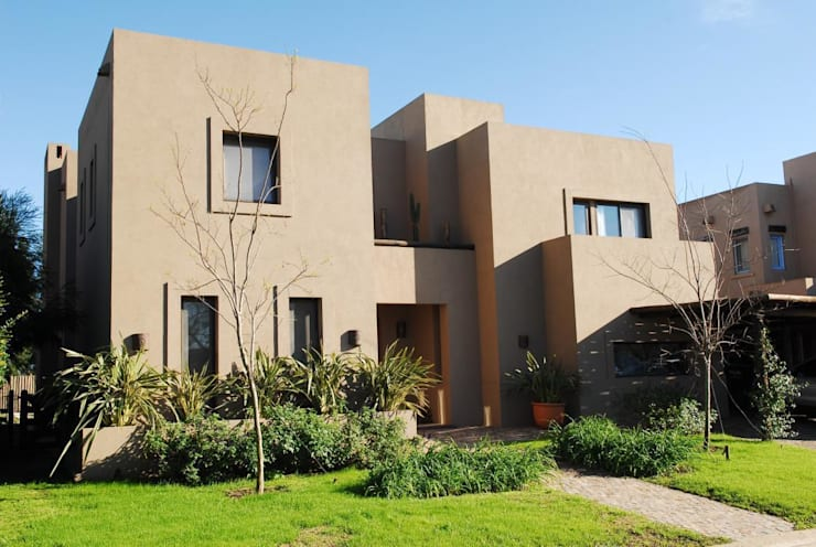 CASA TECTÓNICA EN TIGRE: Casas de estilo  por Parrado Arquitectura
