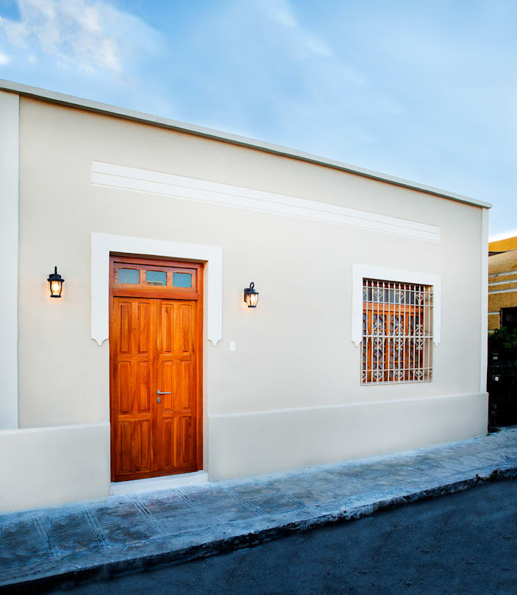 Casa FS55: Casas de estilo  por Taller Estilo Arquitectura