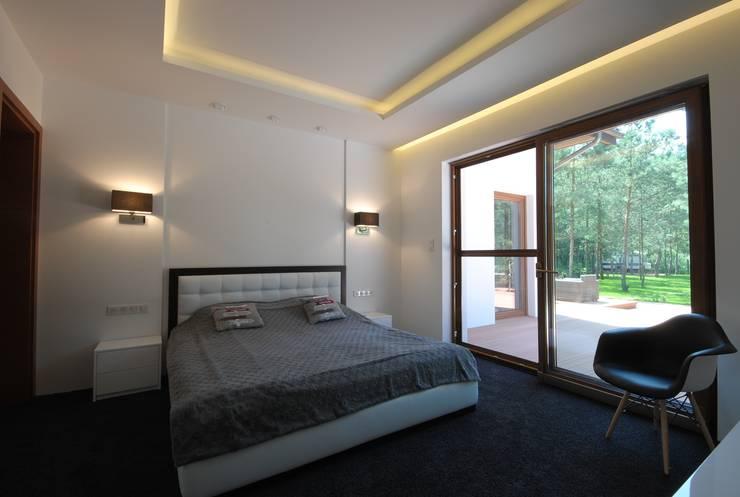 PROJEKT DOMU W ŁOWICZU 200mkw: styl , w kategorii Sypialnia zaprojektowany przez Piotr Stolarek Projektowanie Wnętrz,Nowoczesny