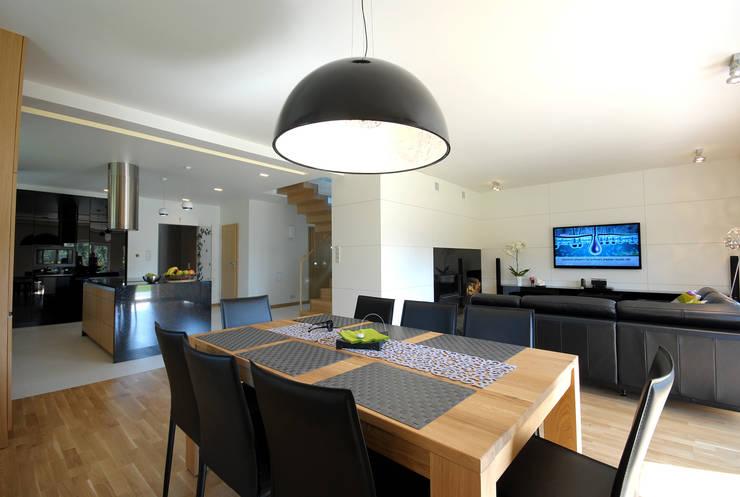 Projekt wnętrza domu w Łodzi 160mkw.: styl , w kategorii Jadalnia zaprojektowany przez Piotr Stolarek Projektowanie Wnętrz,