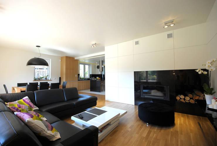 Projekt wnętrza domu w Łodzi 160mkw.: styl , w kategorii Salon zaprojektowany przez Piotr Stolarek Projektowanie Wnętrz,