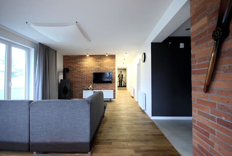 projekt wnętrza domu w Wiśniowej Górze -156mkw: styl , w kategorii Salon zaprojektowany przez Piotr Stolarek Projektowanie Wnętrz