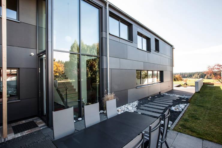 Projekty, eklektyczne Domy zaprojektowane przez 21-arch GmbH