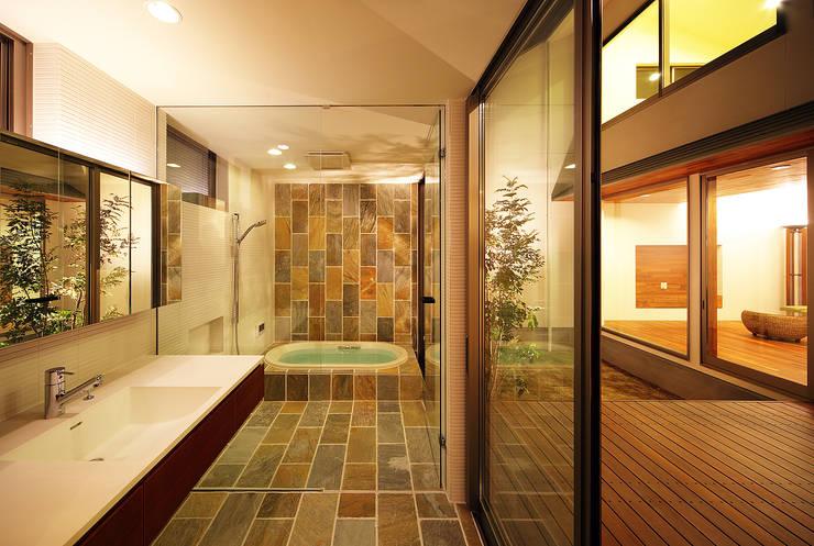haus-vila: 一級建築士事務所hausが手掛けた浴室です。