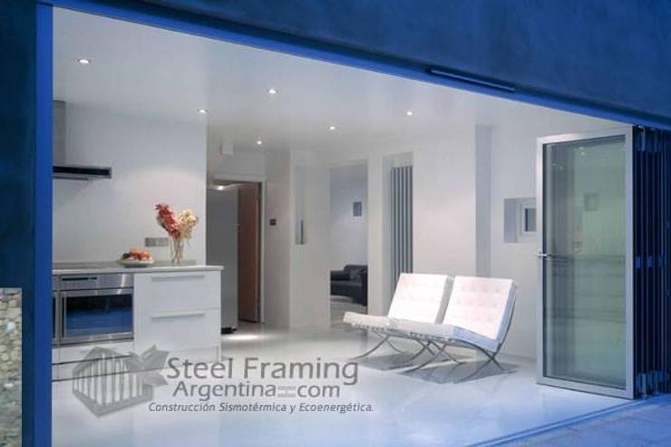 Interiores de Casas en Steel Framing: Livings de estilo  por Steel Framing Argentina,Moderno Hierro/Acero