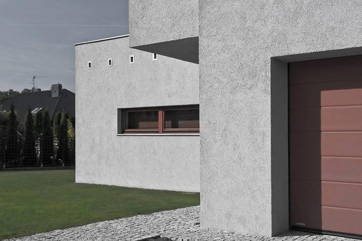 Projekt domu jednorodzinnego – Poznań: styl , w kategorii Domy zaprojektowany przez Konrad Idaszewski Architekt,Nowoczesny