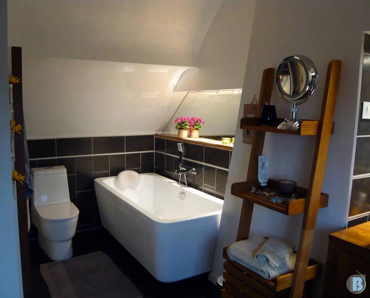 Extention par l'aménagement d'un grenier. Maison normande : Salle de bains de style  par Batbau'bio