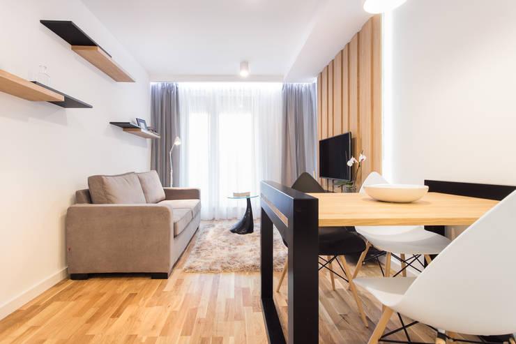 NADWIŚLAŃSKA 11 - 36m2: styl , w kategorii Salon zaprojektowany przez UNQO
