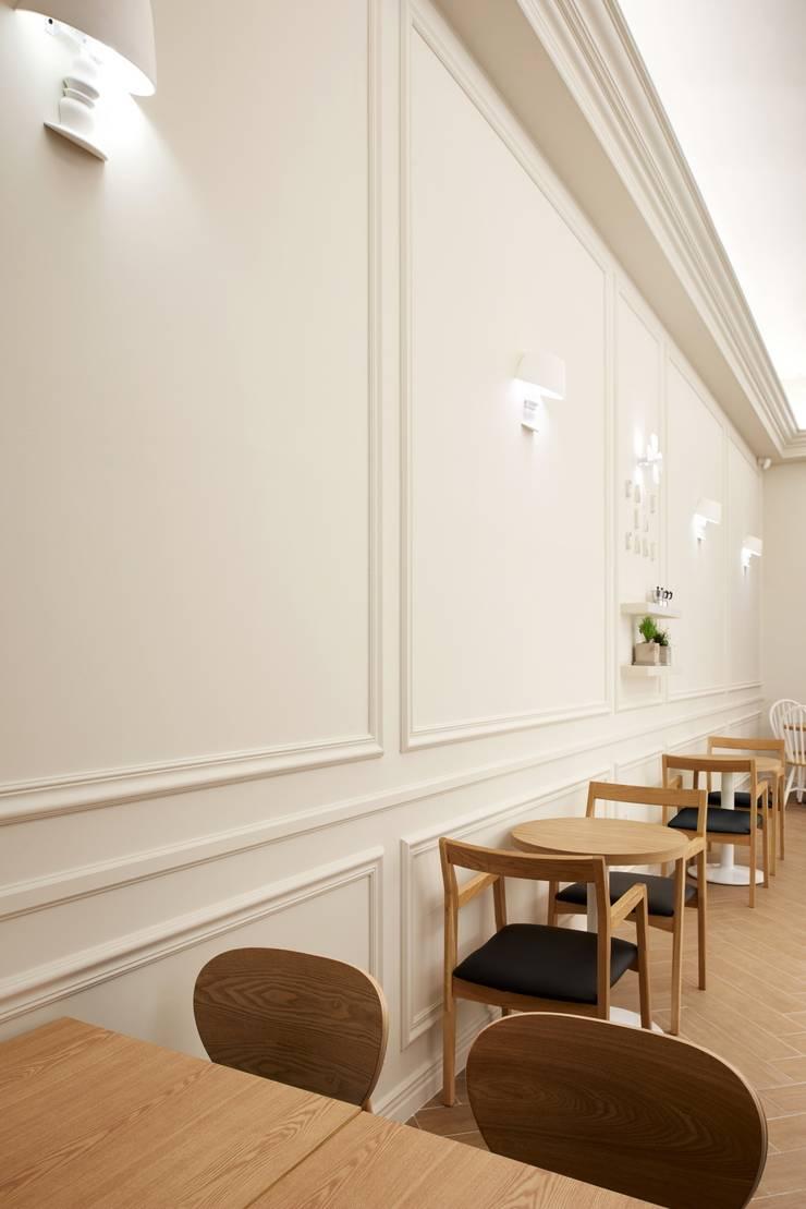 홈 베이킹을 표현해줄 몰딩 벽: Design m4의  상업 공간,모던