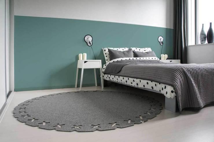 Projekty,  Sypialnia zaprojektowane przez Evelien Lulofs