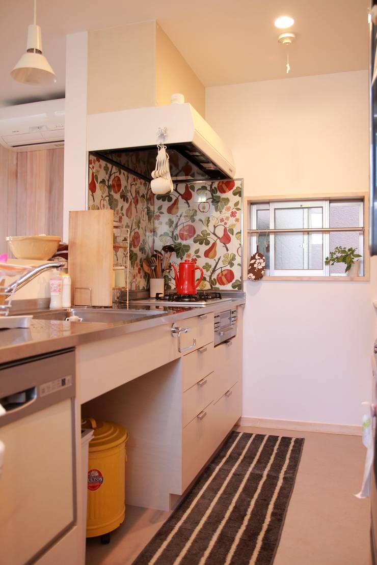 毎日が楽しくなるキッチン: 池田デザイン室(一級建築士事務所)が手掛けたキッチンです。