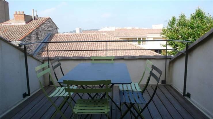 Vue de la terrasse: Terrasse de style  par AGENCE D'ARCHITECTURE BRAYER-HUGON