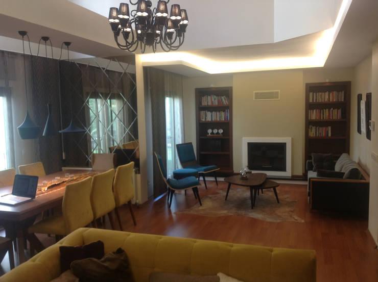 HEBART MİMARLIK DEKORASYON HZMT.LTD.ŞTİ. – Hüseyin  Aymutlu Evi: modern tarz Oturma Odası