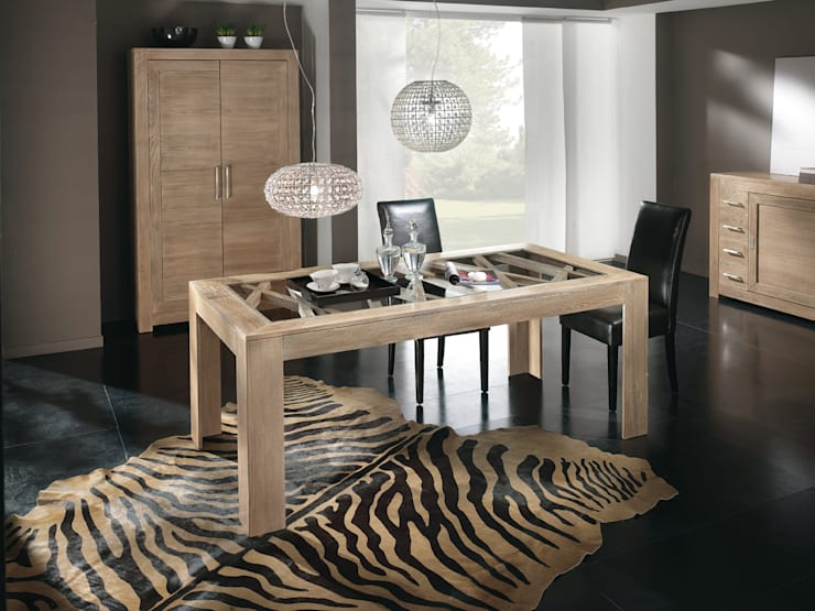 Tavolo con greca: Sala da pranzo in stile in stile Moderno di CORDEL s.r.l.