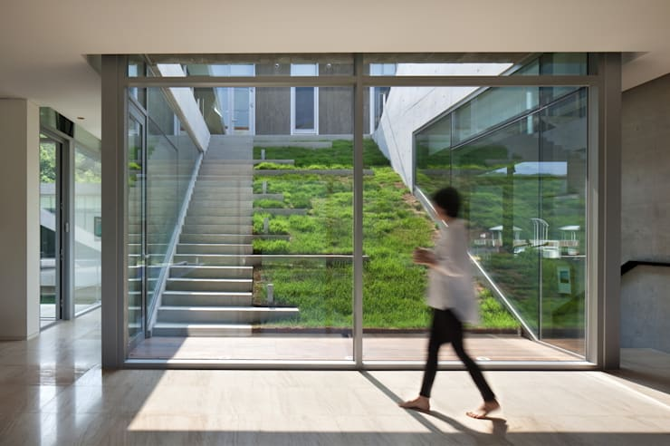 Guesthouse Rivendell: KWAK, HEESOO [IDMM Architects]의  복도 & 현관