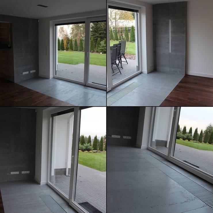 Idealne płyty z betonu: styl , w kategorii Salon zaprojektowany przez Luxum,Nowoczesny