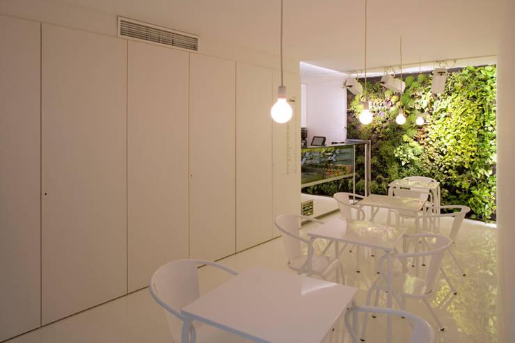 Just Cuore: Espaços de restauração  por TERNULLOMELO Architects