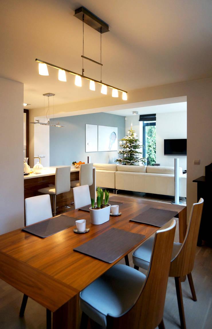 Rozbudowa domu: styl , w kategorii Jadalnia zaprojektowany przez Grid Architekci ,
