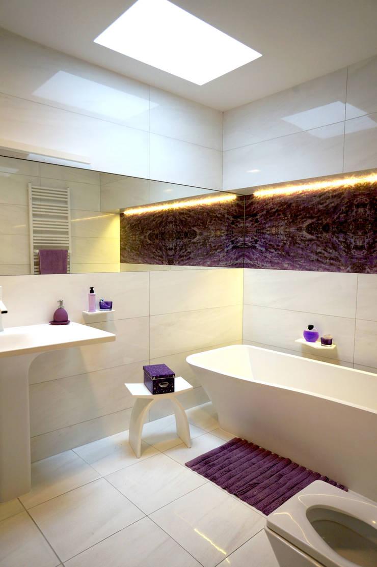 Rozbudowa domu: styl , w kategorii Łazienka zaprojektowany przez Grid Architekci ,